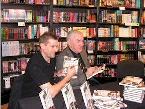Dave Mackay and Phil Gee sign the new Derby County Book