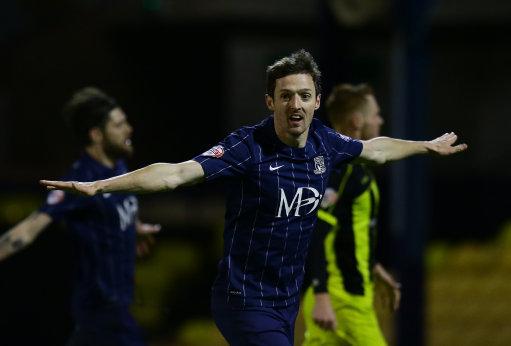 Southend United's David Mooney celebrates scoring his sides third goal of the game against Burton Albion.